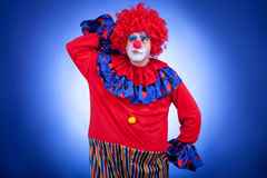 Surprised clown men on blue background Royalty Free Stock Images