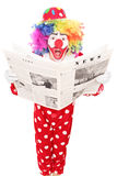 Surprised clown reading a newspaper Royalty Free Stock Photo