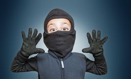 Surprised comic burglar stopped and take his hands up. Caricature figure of a surprised comic burglar who stopped and take his hands up royalty free stock image