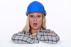 A surprised construction worker. A surprised female construction worker Royalty Free Stock Photos