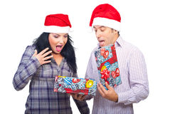 Surprised couple of Christmas present stock images
