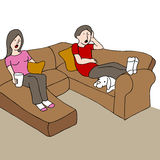 Surprised Couple On Couch Royalty Free Stock Photos