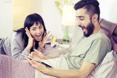Surprised couple having won game online with tablet Stock Image