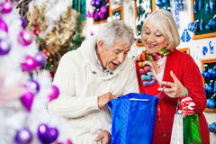 Surprised Couple Looking Into Shopping Bag Royalty Free Stock Photos