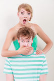 Surprised couple wide eyed girl covering mouth her man Royalty Free Stock Photography