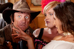 Surprised Cowboy and Two Lovely Women Royalty Free Stock Photography