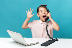 Surprised, Cute asia little girl is sitting at table with her wh Stock Photography