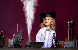 Surprised cute girl looking at evaporation reagent Stock Photography
