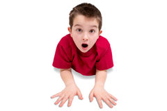 Surprised Cute Male Kid Lying on his Stomach stock image
