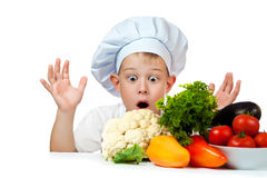 Surprised cute scullion with raw vegetables Stock Images