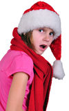 Surprised or disappointed child with Santa Claus red hat Stock Image