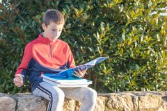 Surprised teenager with textbooks and notebooks royalty free stock photography
