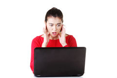 Surprised and disgusted woman working on laptop Royalty Free Stock Photo