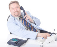 Surprised doctor calling at desk Stock Images