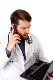 Surprised Doctor on the Phone Royalty Free Stock Photography
