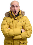 Surprised dude wearing a yellow winter jacket Royalty Free Stock Image