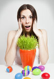 Surprised easter girl. Amazed woman with easter eggs and green grass Royalty Free Stock Photo