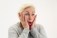 Surprised elderly lady isolated. Female with hands on face. See the unbelievable royalty free stock images