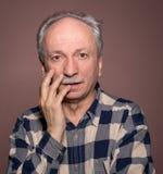 Surprised elderly men Stock Photography