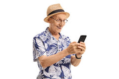 Surprised elderly tourist using a phone Royalty Free Stock Photo