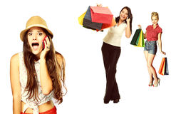 Surprised emotional girl talking on mobile phone about shopping sale Royalty Free Stock Photography