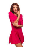 Surprised excited beautiful brunette woman. In pink dress isolated Royalty Free Stock Image