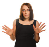 Surprised excited brunette woman throws up his. Hands opened her mouth isolated Stock Photos