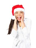 Surprised excited christmas woman. Christmas girl very excited and surprised holding her head. Beautiful mixed asian / caucasian model. Isolated on seamless Stock Photography