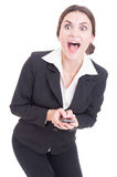 Surprised, excited and happy business woman texting on smartphon Stock Image