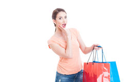 Surprised and excited woman holding shopping bags Stock Photography