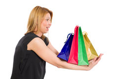 Surprised or excited woman holding shopping bags Royalty Free Stock Images