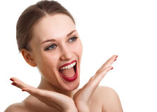 Surprised excited woman screaming amazed in joy. Isolated on white Stock Images