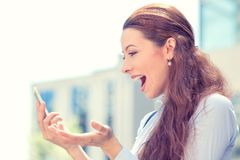 Surprised excited young girl looking at phone Royalty Free Stock Photo