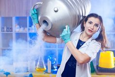 Surprised woman with metal gas container stock image