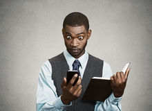 Surprised executive reading breaking news on smart phone Stock Photo