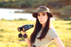 Surprised Explorer Girl with Camouflage Hat and Binoculars Royalty Free Stock Photos