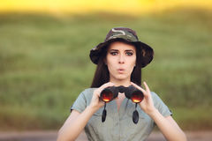 Surprised Explorer Girl with Camouflage Hat and Binoculars Stock Images