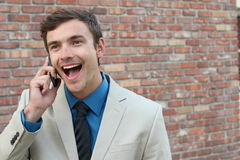 Surprised face and big eyes while receiving a positive call Stock Photos