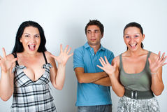 Surprised faces. A man with a mug on face looking at two woman with surprised faces,check also Friends Stock Images