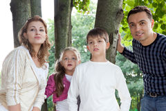 Surprised family of four outdoors Stock Photography