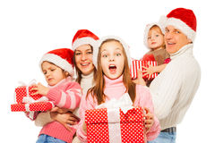 Surprised family with presents and. Surprised girl with large family together with red box presents standing isolated on white stock images