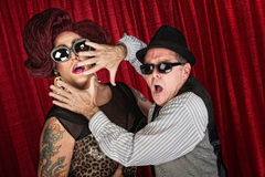 Surprised Famous Couple. Surprised drag queen and partner in sunglasses Stock Images