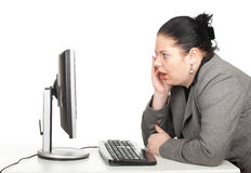Surprised fat businesswoman. In grey suit with computer, series Royalty Free Stock Photography