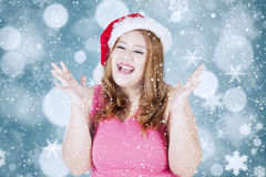 Surprised fat woman wearing a santa hat Stock Photo