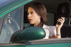 Surprised female in car Stock Photo