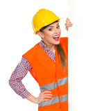 Surprised Female Construction Worker And A Banner Stock Image
