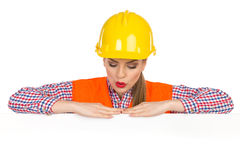 Surprised Female Construction Worker Reading Royalty Free Stock Photography