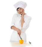 Surprised female cook speaking on the phone Stock Photo