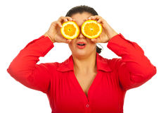 Surprised female holding orange Royalty Free Stock Image