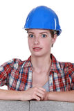 Surprised female mason Stock Photography
